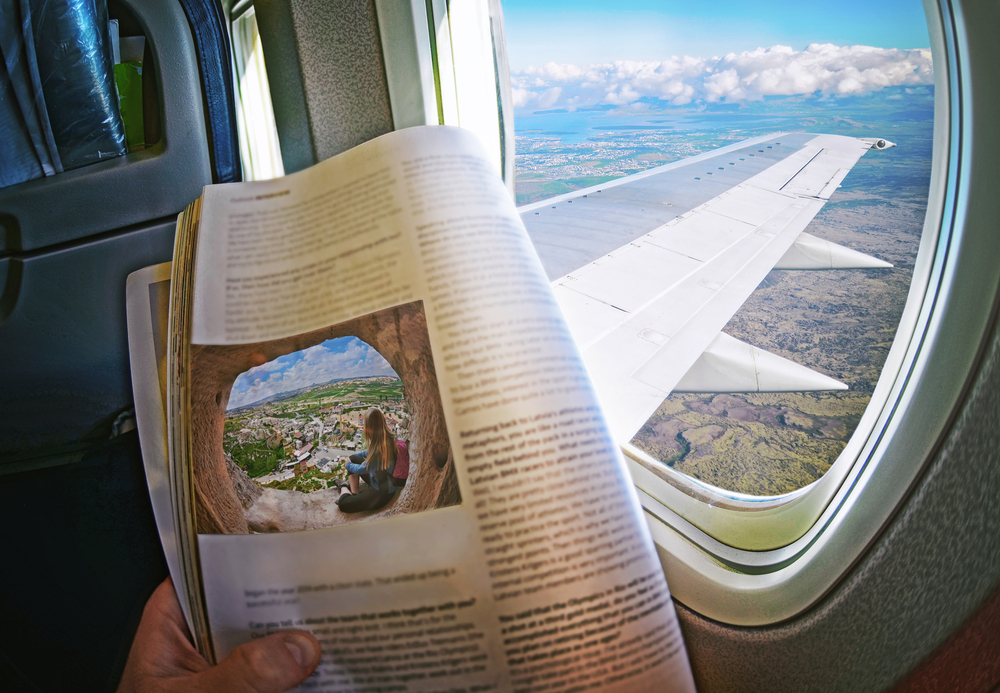 magazine reader in airplane