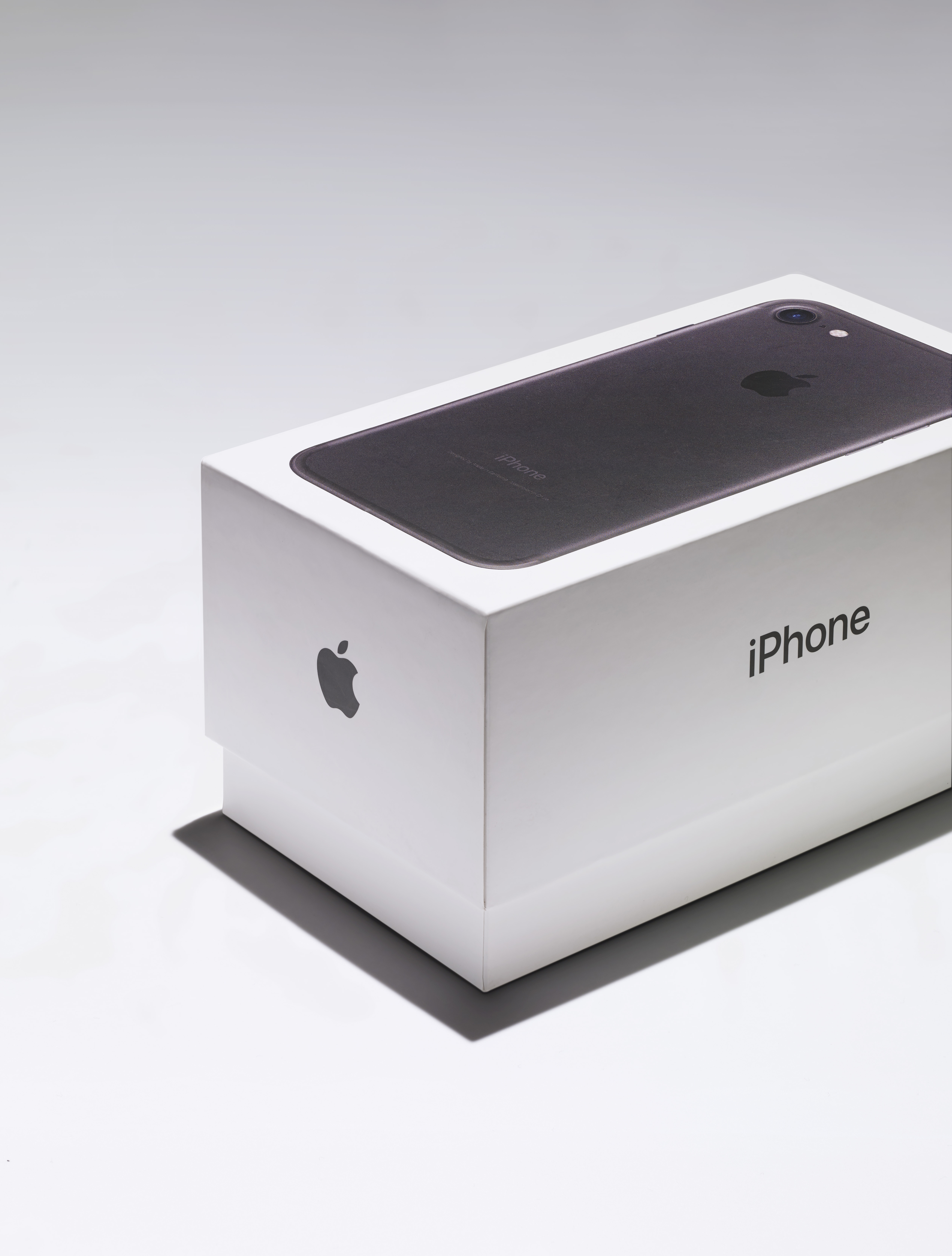 A close-up of a black iPhone box showcasing Apple's smooth, tactile packaging